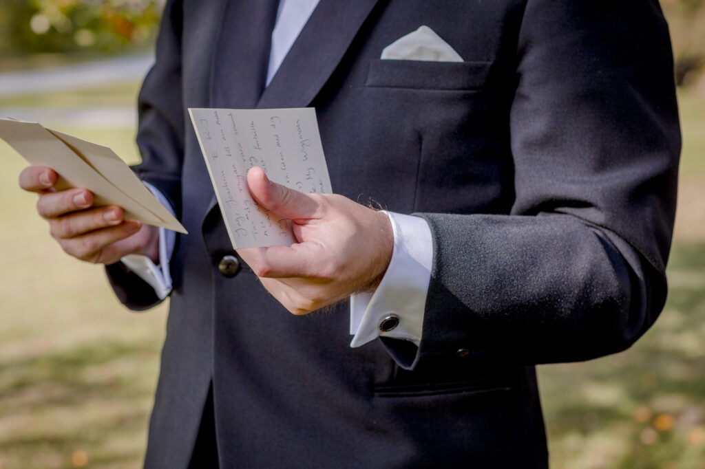 Close up of the vows in his hands