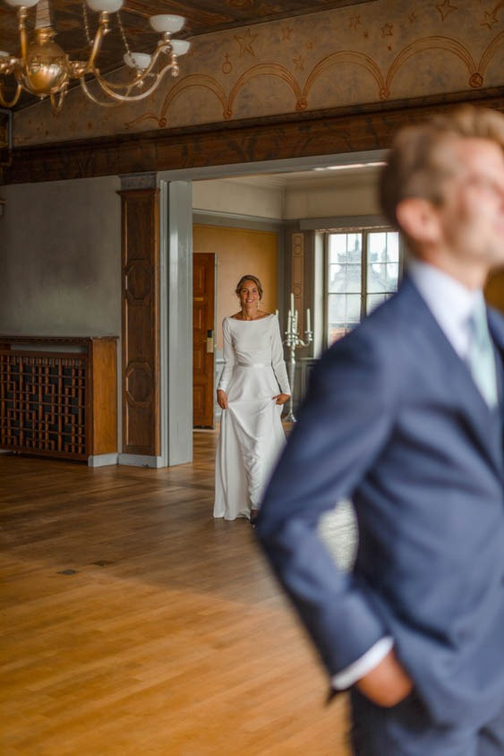 Bride walking towards the groom for their first look at Hasselbacken