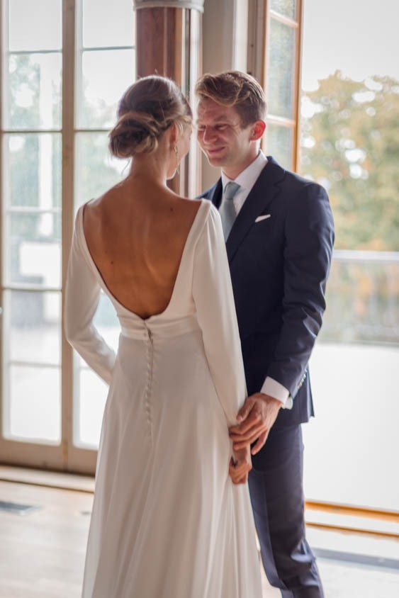 Groom looking happy to see his bride during first look at Hasselbacken
