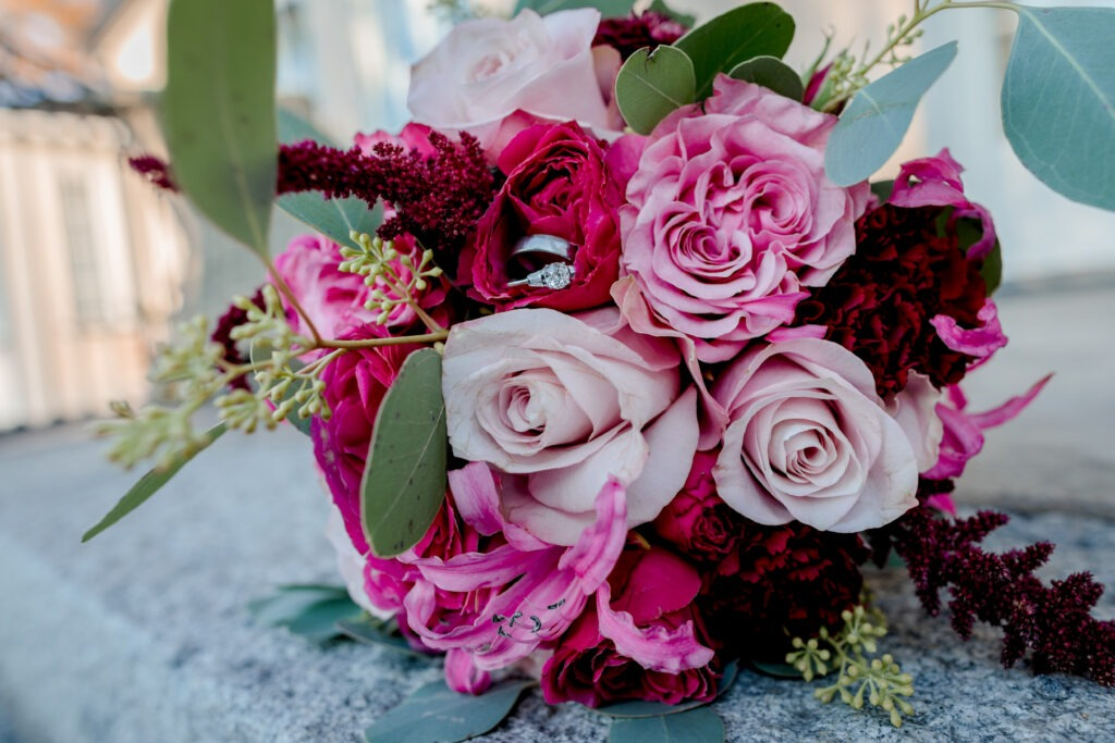 Detail photo of the bouquet and rings in the afternoon sun