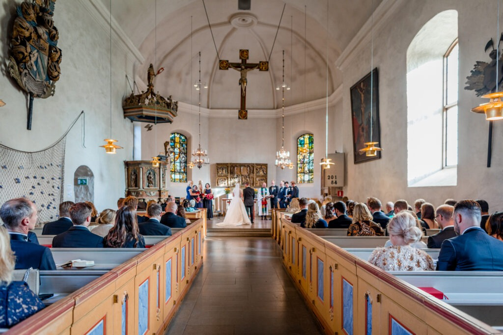 Couple ready to walk out of church newly wedded