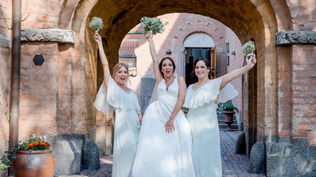 A bride tribe partypose into the camera