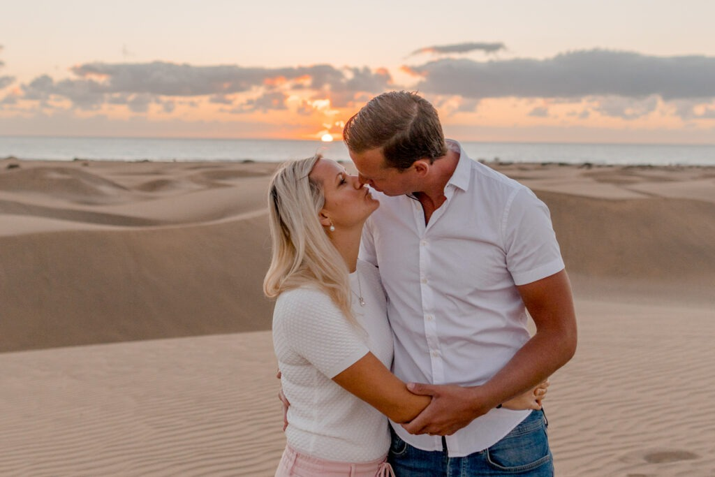 Couple kissing in sunrise over Maspalomas sand dunes, Gran Canary