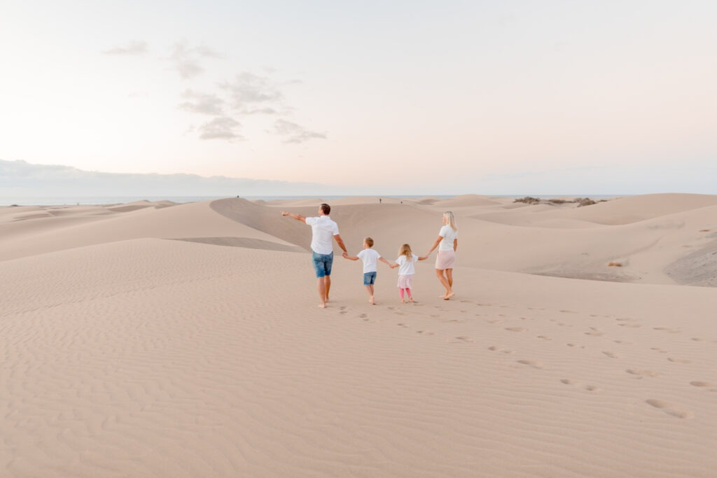 Walking together hand in hand this two kid family in maspalomas gran canary