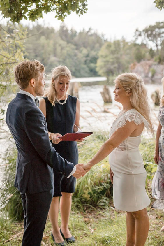 Wedding ceremony by the shore  elopement in stockholm