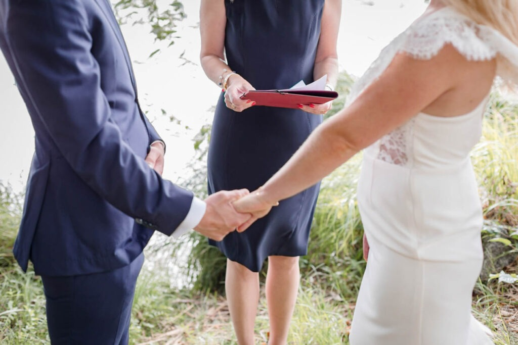 Couole holding hands during their elopement ceremony