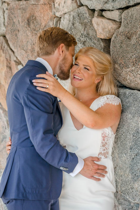 Groom whispers something in his brides ear elopement in Stockholm