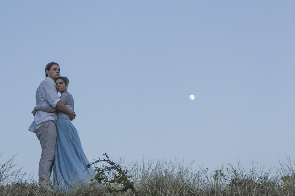 Couple holding each other under the moon in Provence