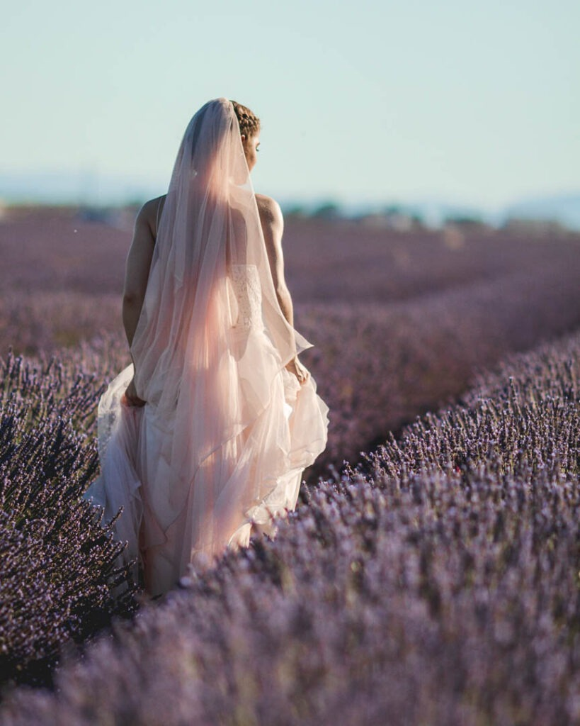 Walking bride in lavender fiends as part of a two day elopement in provence