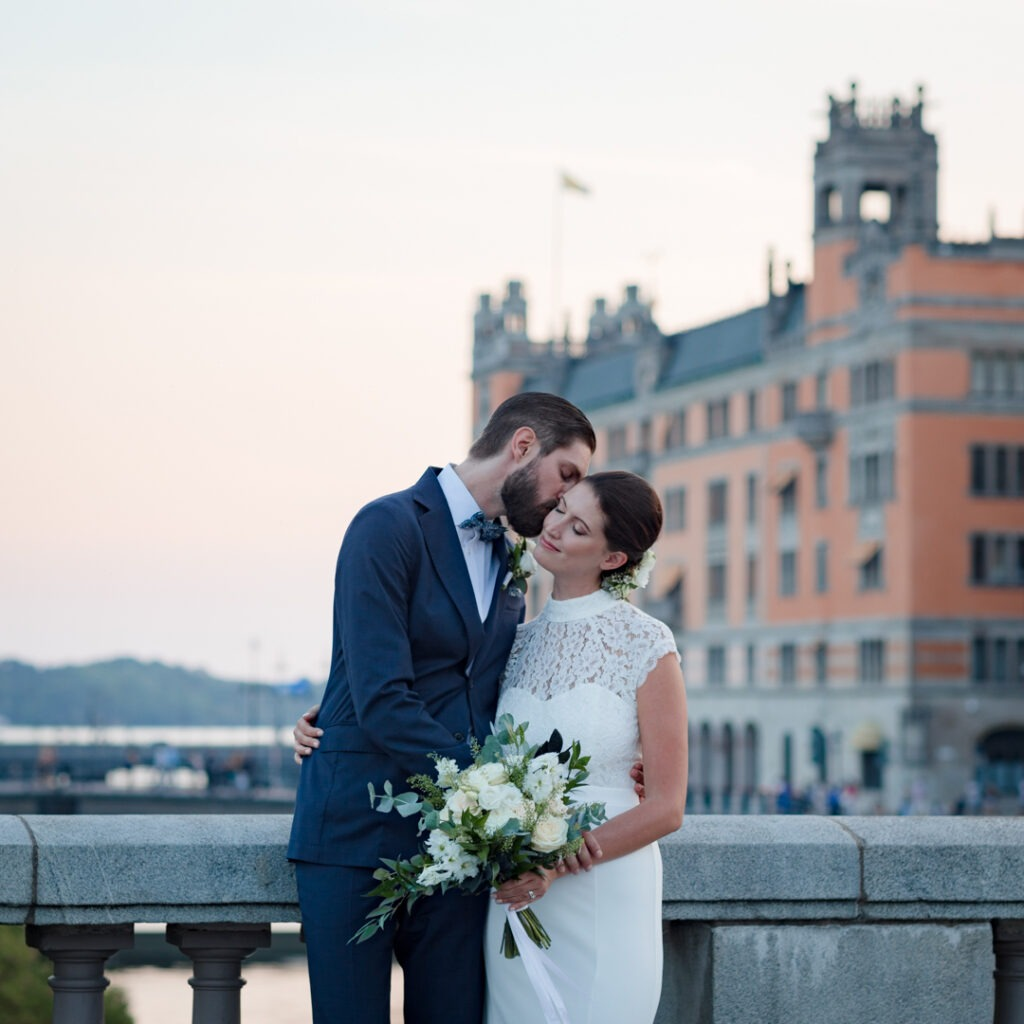 summer sunset in Stockholm, a couple is holding each other