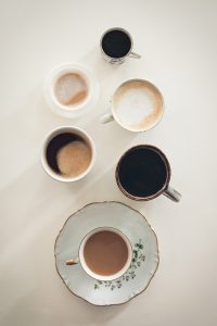 it's coffee o'clock. A selection of different coffees in different cups.