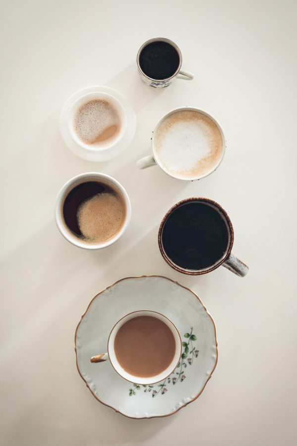 web-shop and a selection of different coffees in different cups.