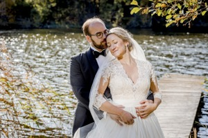 Stunning photo of the bride is leaning against his chest