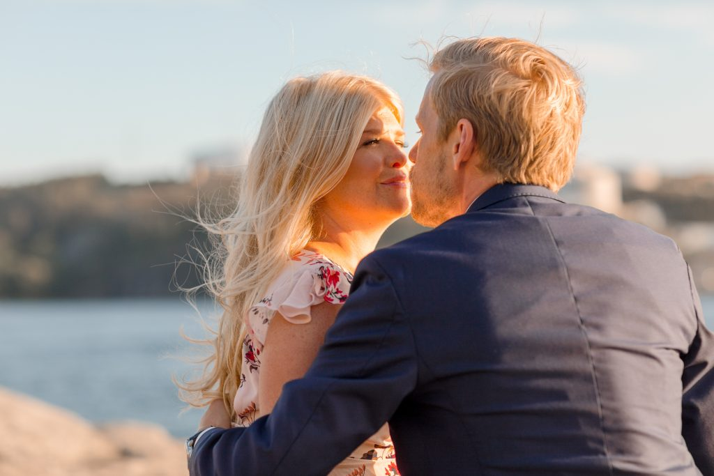 Sunset lights in couples facec on the cliffs of Fjäderholmarna