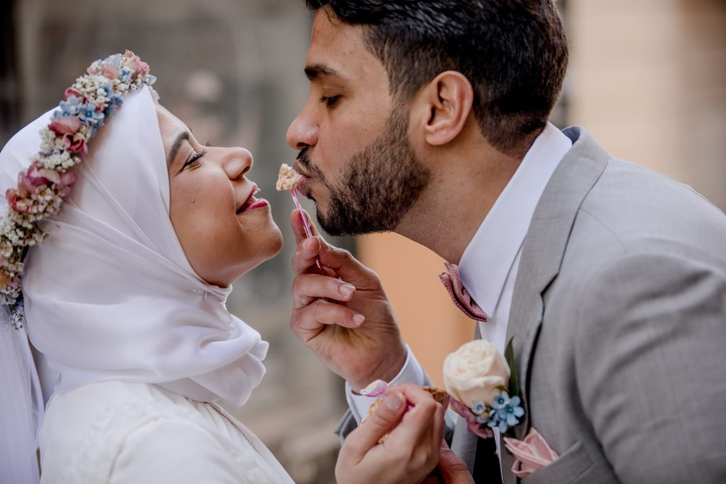 Wedding couple sharing a cone with icecream