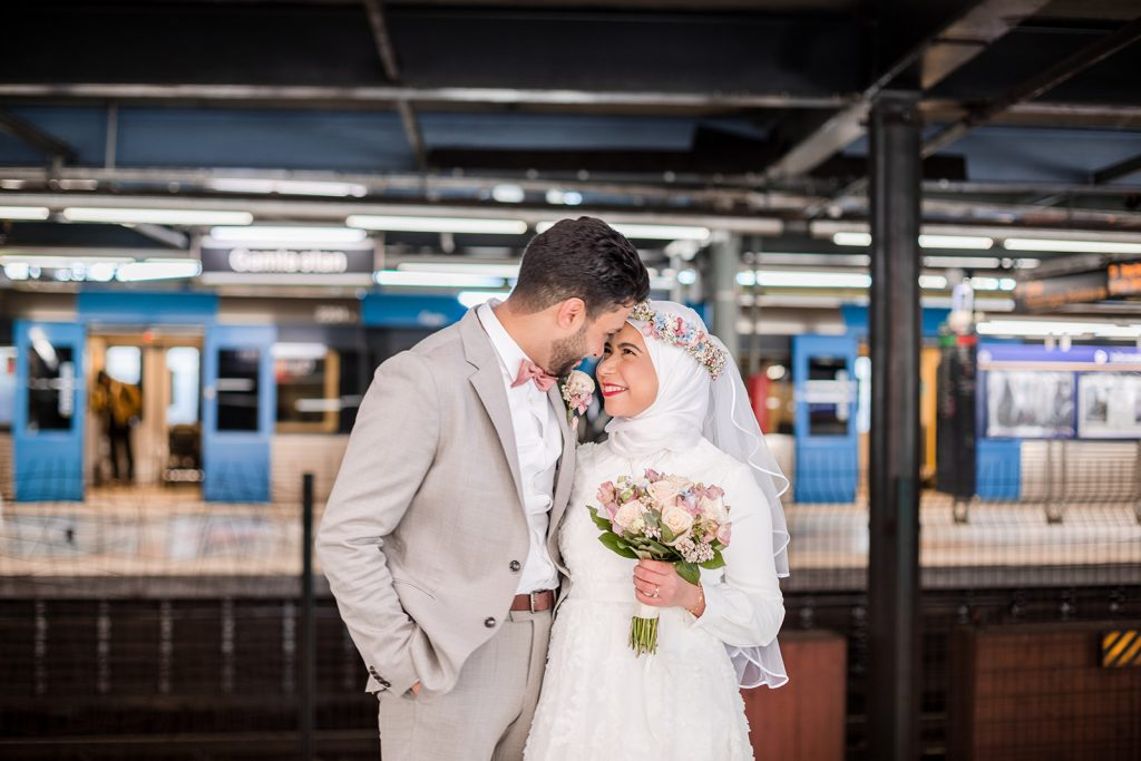 a wedding couple on the subway station in stockholm on their weddingday