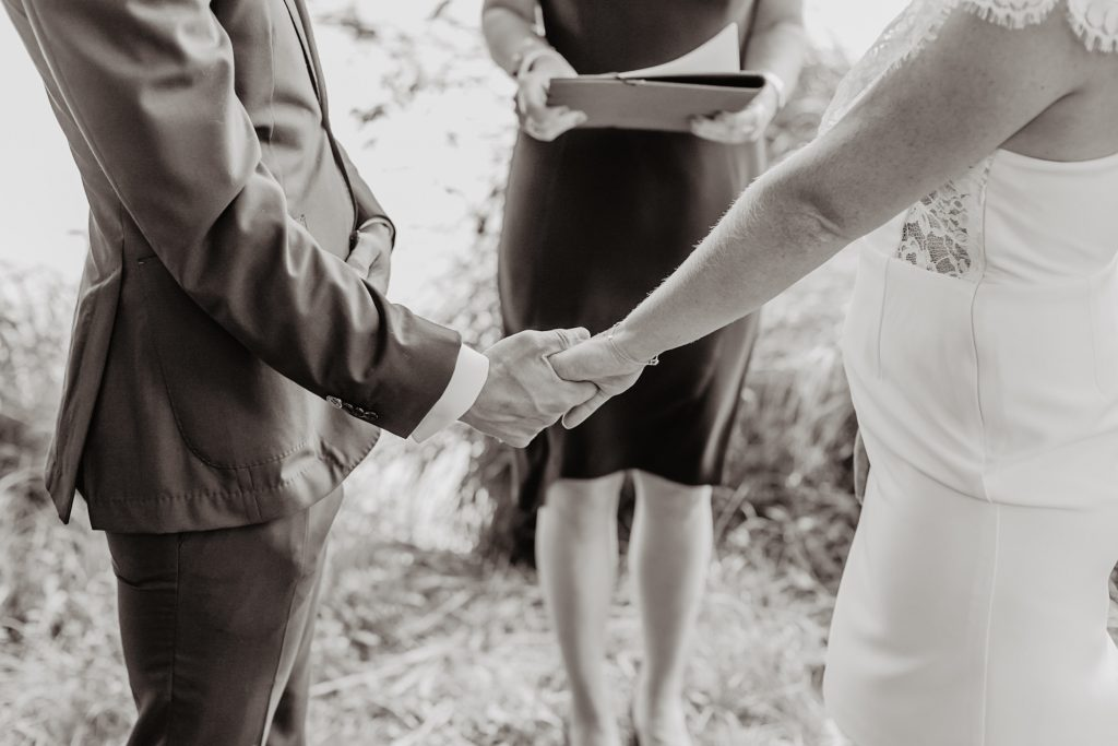 narrow your guest list and your elopement experience holding hands during elopement