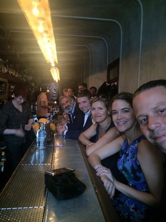 your elopement experience guests sitting in a hidden bar in NYC