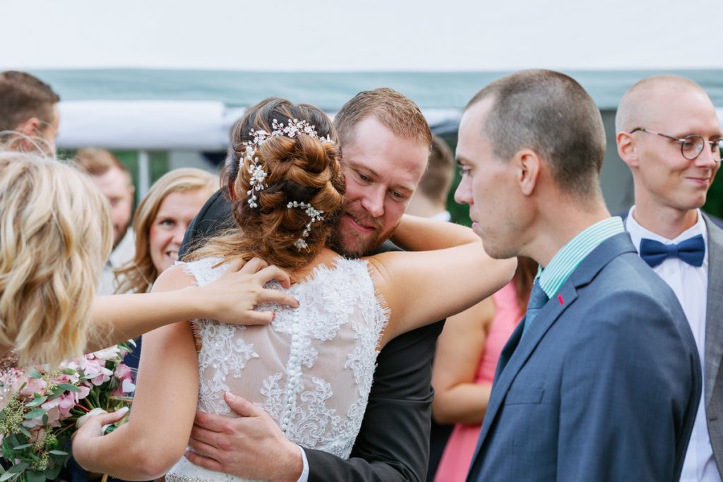 bridal hairdo's when she gets hugs and congratulations by family and friends