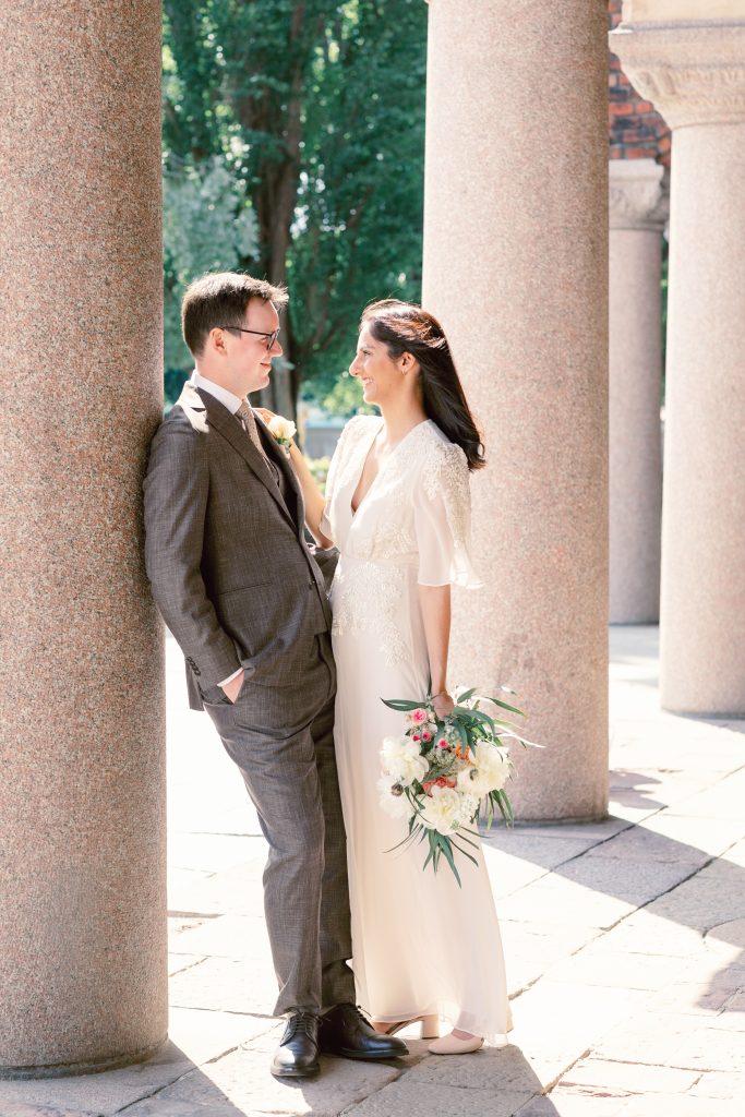 summer elopement in stockholm talking bride and groom
