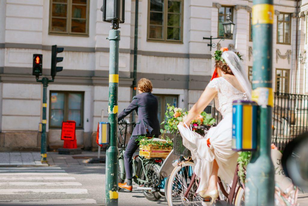 adventure elopement biking towards their wedding at cityhall
