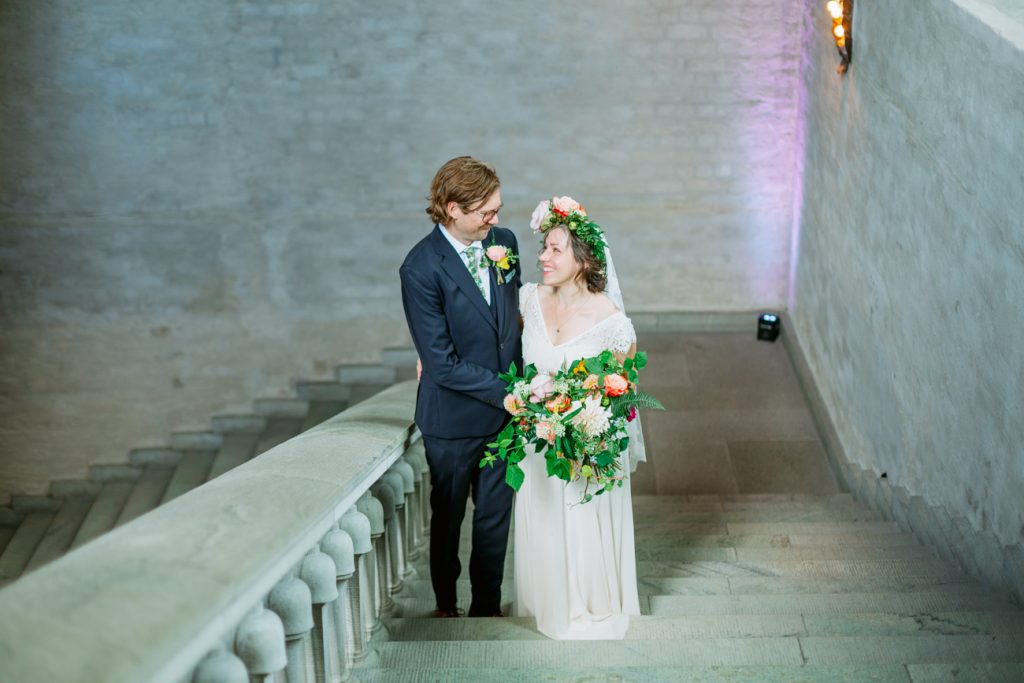 adventure elopement bride and groom in the stairsat Stockholm cityhall