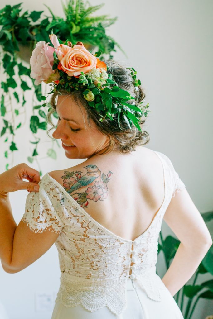 elopement wedding a bride looking over her shoulder at her tattoo