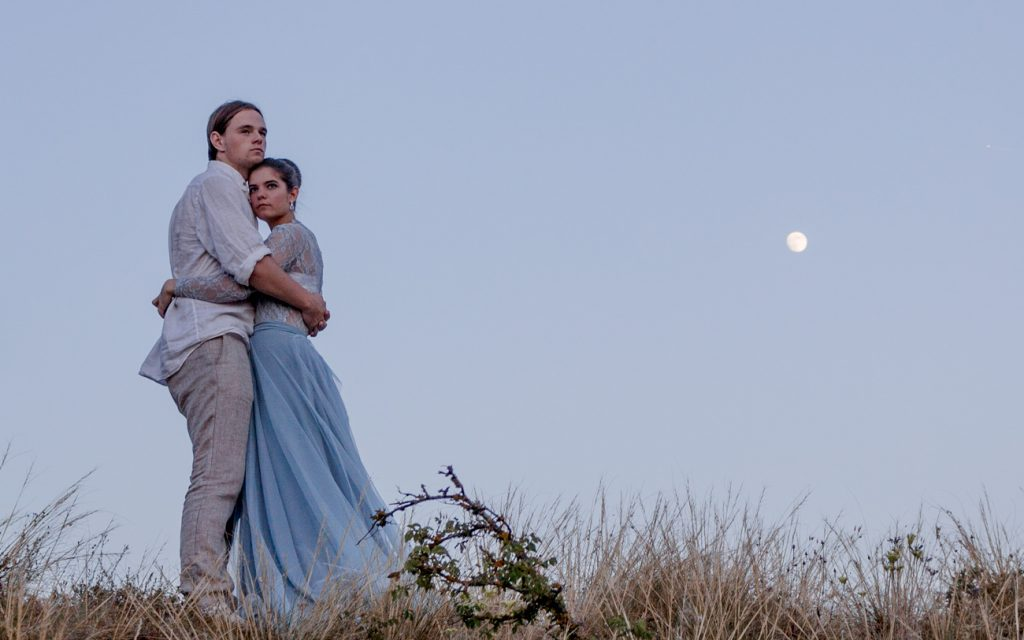 Wedding problems and couple standing under the moon in Provence