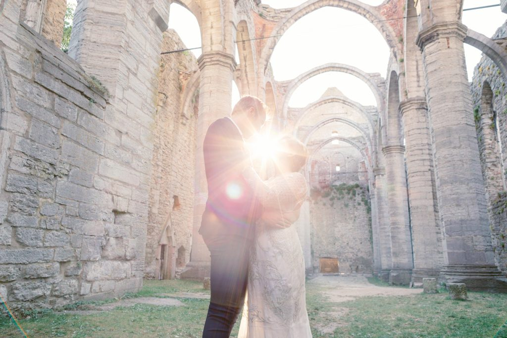 inspirational editorial Gotland visby ruin in backlit between the weddingcouple