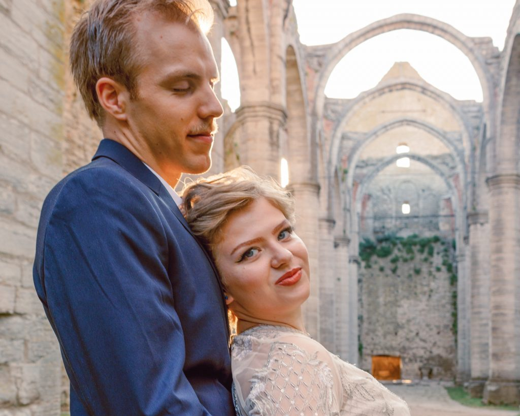 inspirational editorial Gotland visby ruin  bride leaning towards her husbands chest