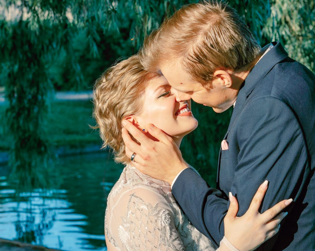 inspirational editorial Gotland visby ruin bride leaning towards her husband for a kiss