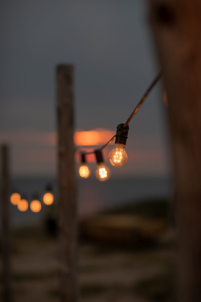 important lessons and a still life photo of golden sunset and lights of the restaurant at Surflogiet Gotland