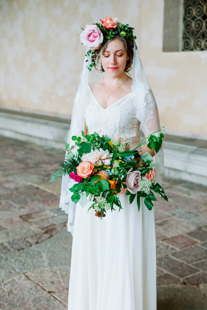 adventure elopement and bride portrait as she is looking at her bouquet