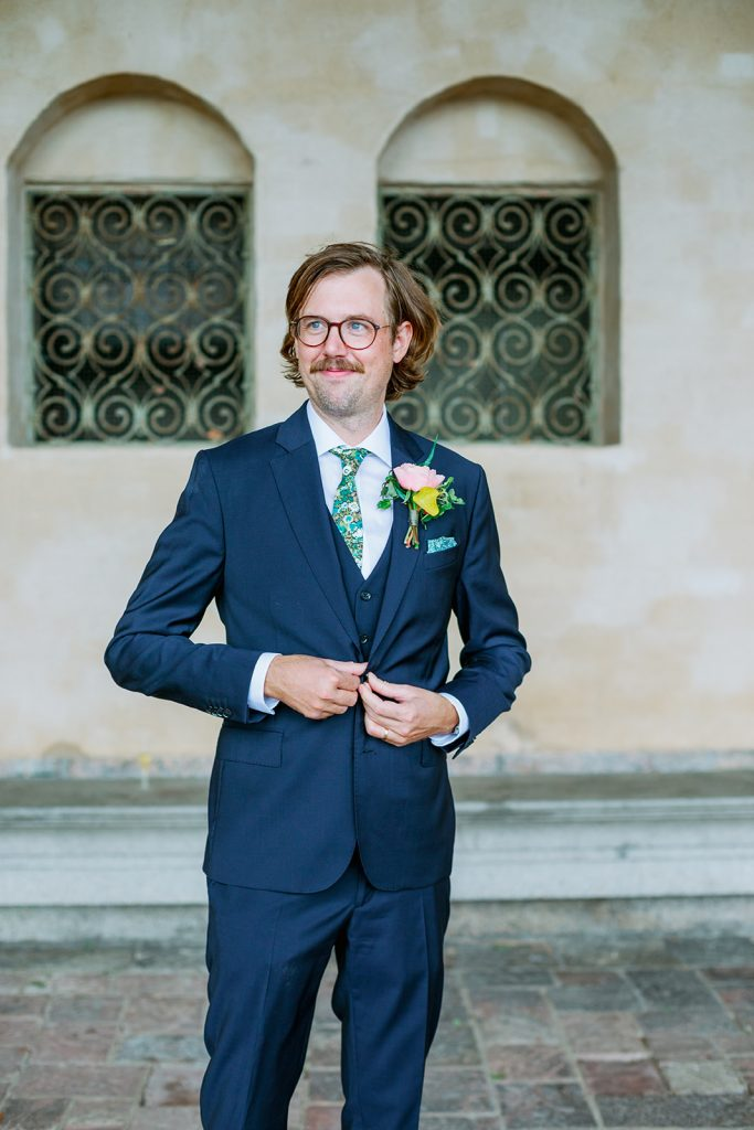 adventure elopement groom portrait by a stone wall