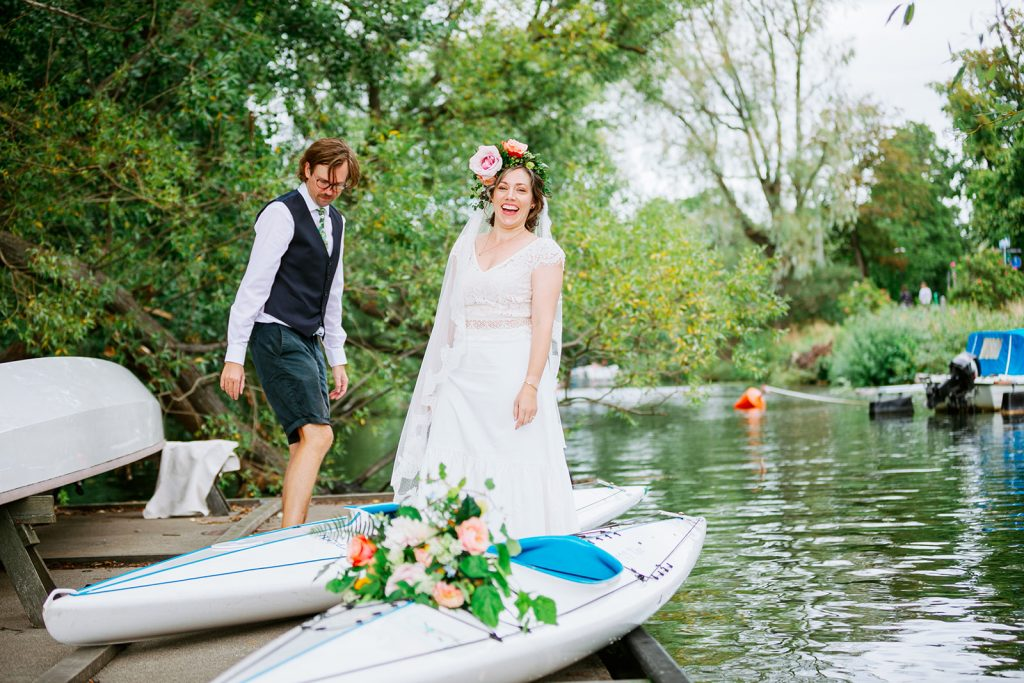 adventure elopement couple ready to put their kayaks in the water