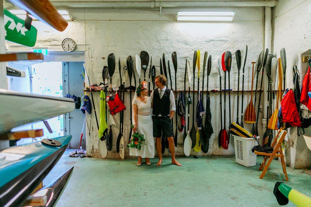 posing, bride and groom among paddles