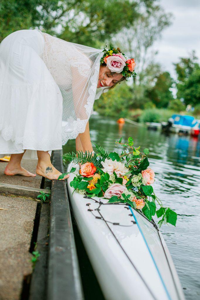 adventure elopement when bride has put her kayak in the water