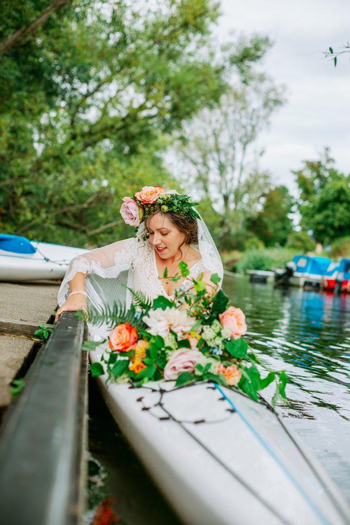 adventure elopement bride getting inside her kayak