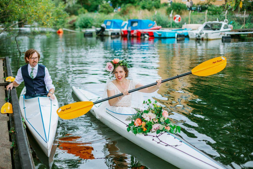 adventure elopement both bride and groom inside their kayak