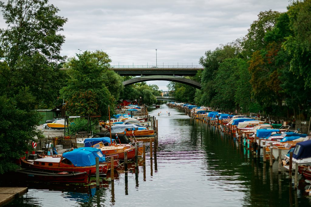 adventure elopement bride and groom kayaking in Stockholm by the wooden boats