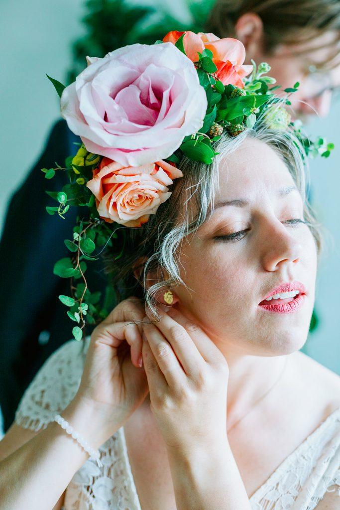 Adventure elopement preparations putting on earrings