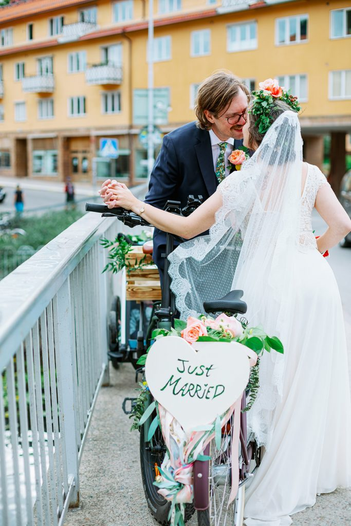 elopement wedding, wedding couple kissing with the bikes