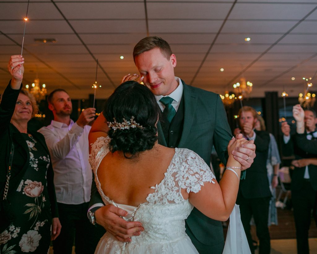 elopement wedding bride wiping a tear from grooms face during first dance
