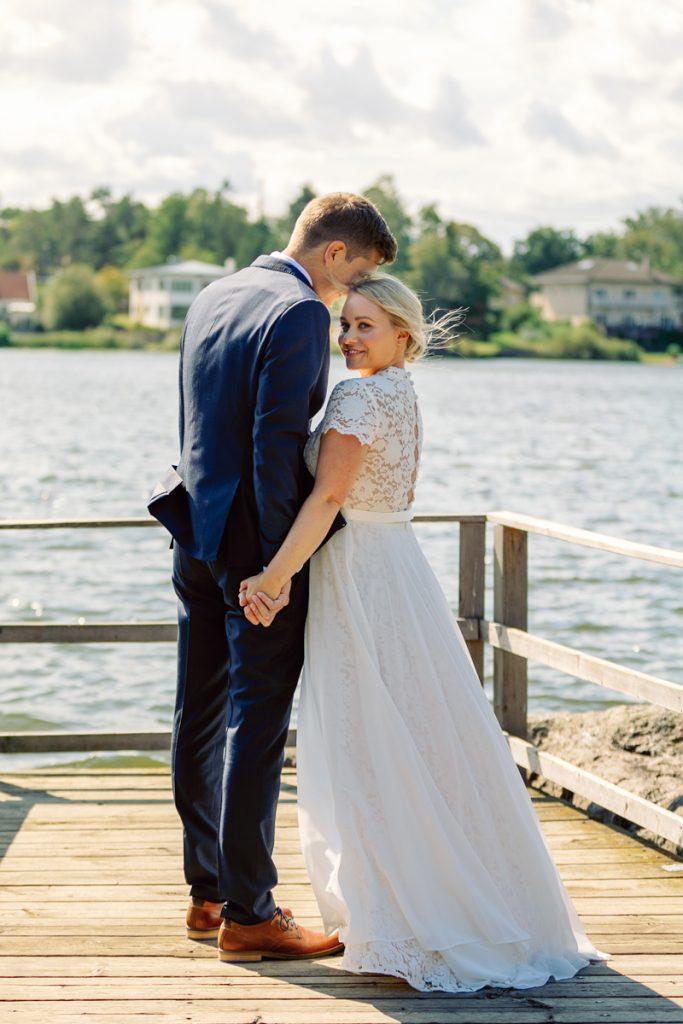 elopement wedding, bridal couple holding hands, bride looking into camera