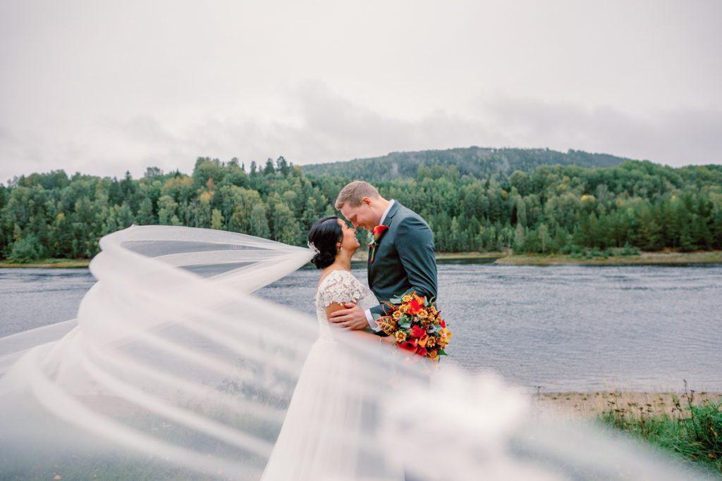 elopement wedding veil portrait bride and groom kissing