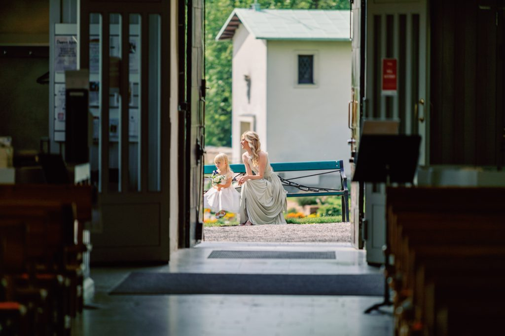 elopement wedding a bridesmaid with one of the children putside of church
