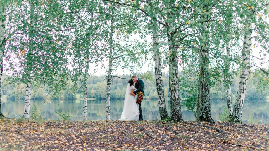 elopement wedding bridal portrait among the trees by a lake