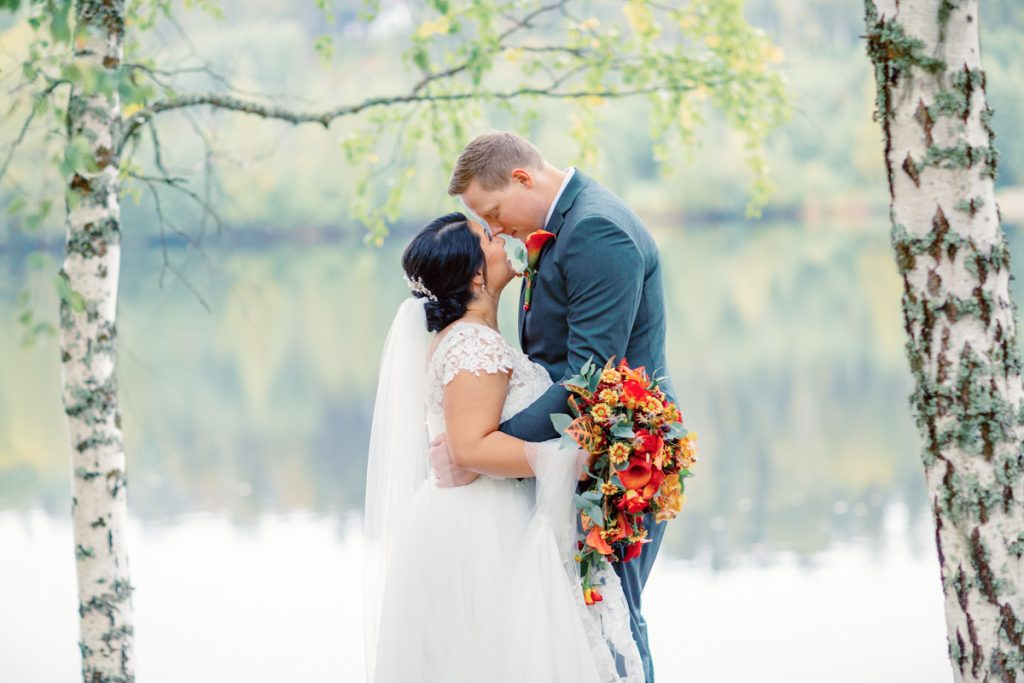 elopement wedding kissing close by the water