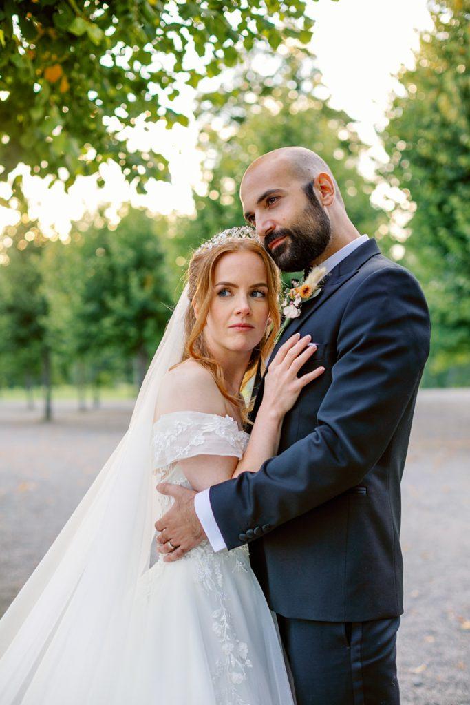 elopement wedding bride and groom in golden hour at royal garden of Drottningholm castle